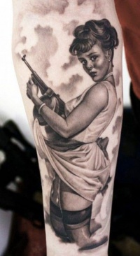 Inimitable pin up girl with arms tattoo by Eric Marcinizyn