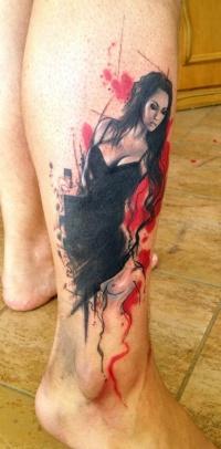 Lovely girl in black dress pin up tattoo on leg by Adam Kremer